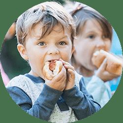 Kid eating a Hofmann Hot Dog
